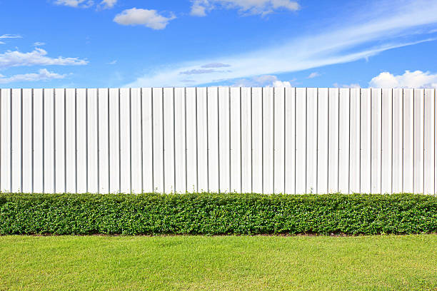 wall and garden - fence stock photos and pictures