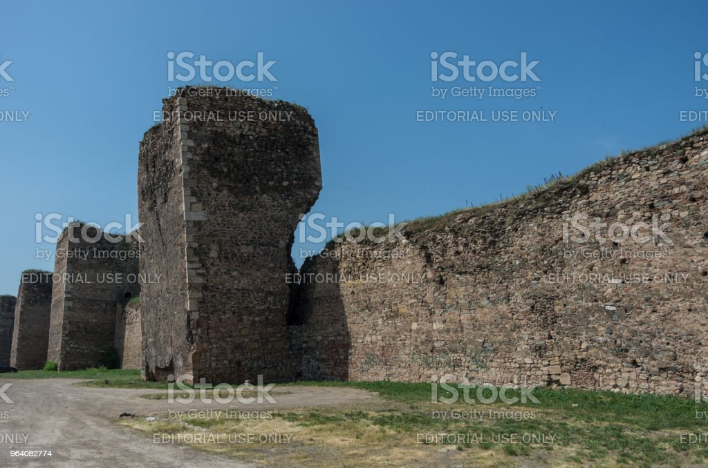Wall and towers of  Smederevo Fortress is a medieval fortified city in Smederevo, Serbia, which was temporary capital of Serbia in the Middle Ages. - Royalty-free Abstract Stock Photo