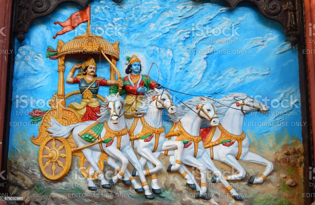 Wall art of Hindu God Krishna as charioteer and Arjuna as warrior in Mahabharata war stock photo