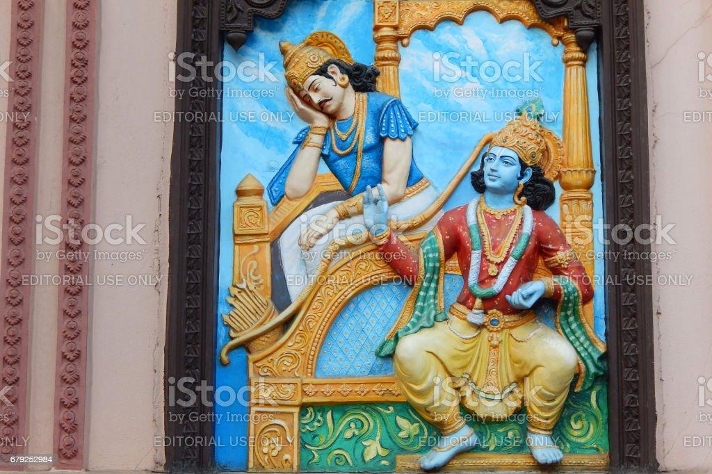 Wall art of Hindu God Krishna tell Bhagavad gita to Warrior Arjuna in Mahabharata war as in Hindu epic stock photo