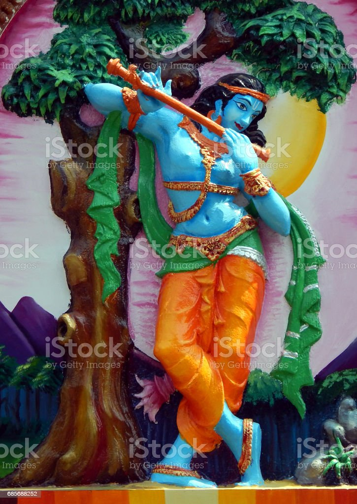 wall art of Hindu God sri Krishna play bansuri side blown flute  in temple,Hyderabad,India. stock photo