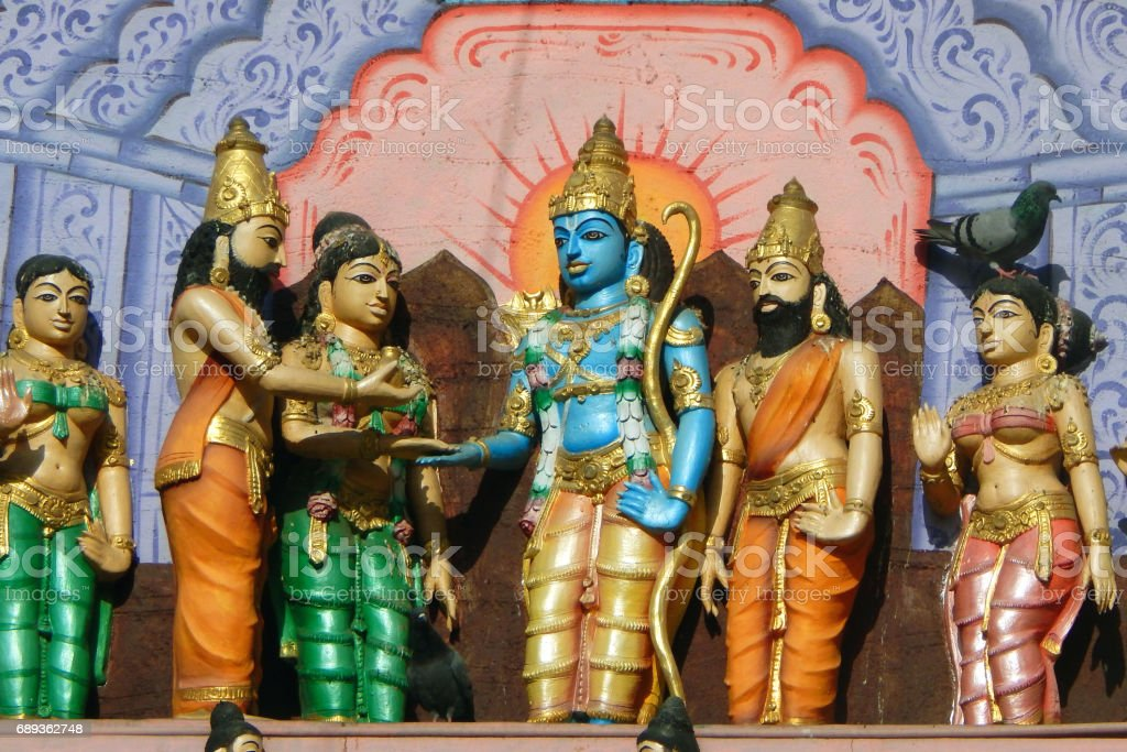 Wall art of Hindu God Sri Rama and Goddess Sita getting married scene or Sita Rama Kalyanam on the exterior of a temple , Hyderabad,India stock photo