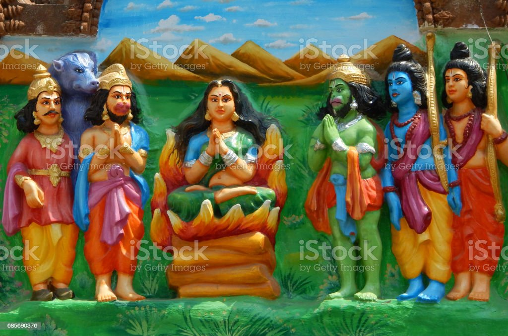 wall art of Hindu Goddess Sita in trial by fire or Agni Pariksha to prove purity as others witness in jagannatha temple Hyderabad,India. stock photo