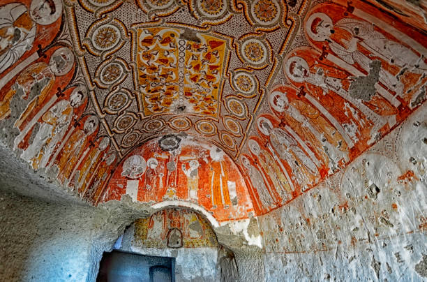 Wall art of old frescoes  and murals in the underground cave churches stock photo