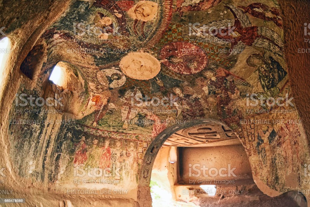 Wall art of old frescoes in the  Church , Goreme stock photo