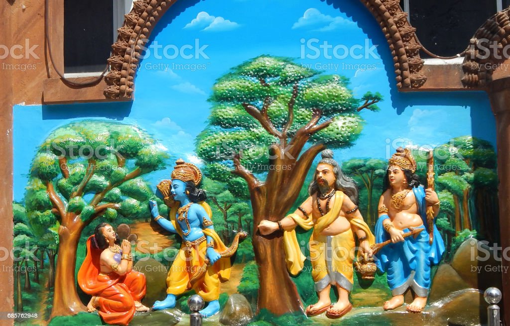 Wall art of Sri Rama bless Sita as Lakshamana and Muni or guru look on as in Ramayana stock photo
