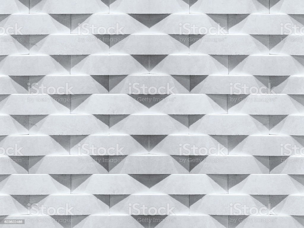 Wall background. Geometric curve stone brick pattern. stock photo