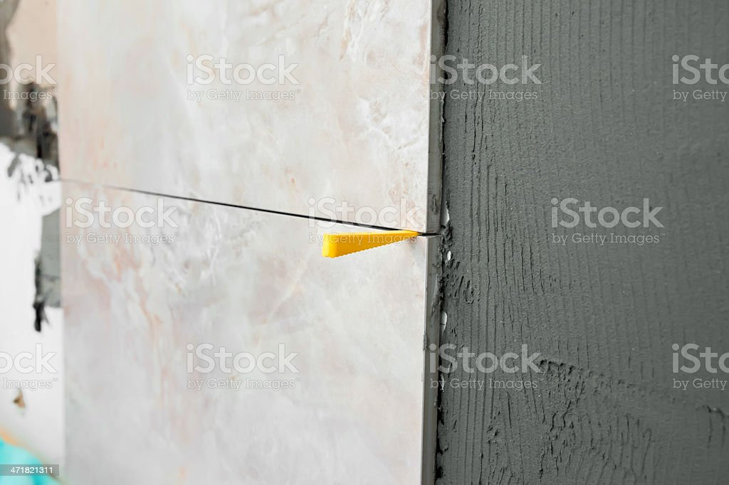 Wall being tiled royalty-free stock photo