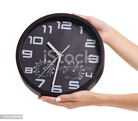 Wall black clock in hand on white background isolation