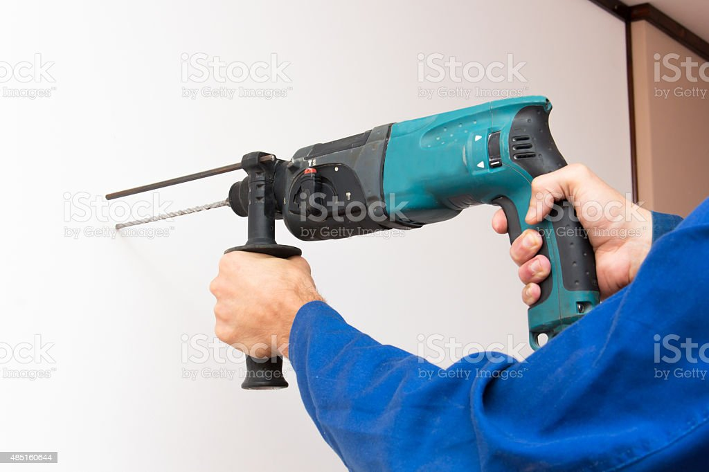 Wall boring by perforator process stock photo