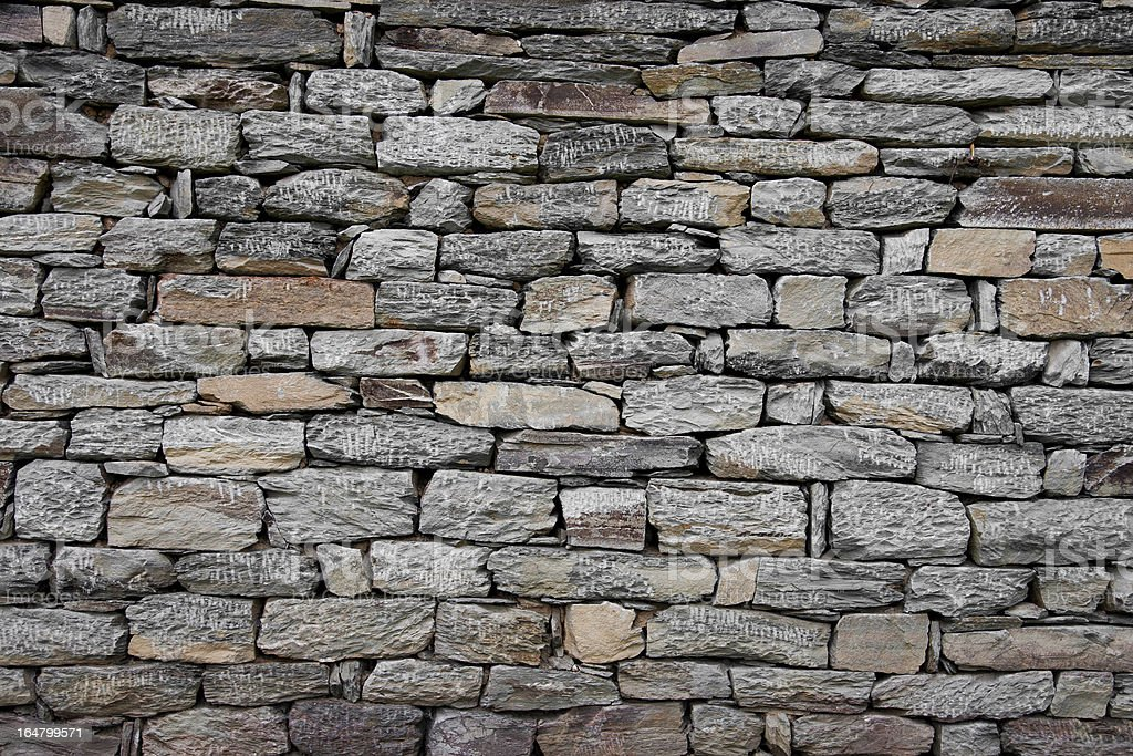Wall built of natural stone royalty-free stock photo