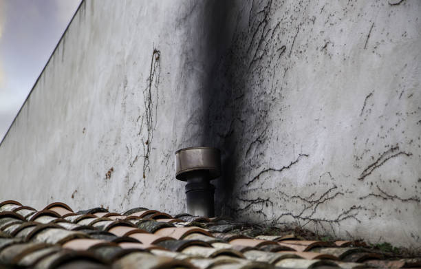 Wall burned by chimney Wall burned by chimney in urban house, fire and destruction, crisis soot stock pictures, royalty-free photos & images
