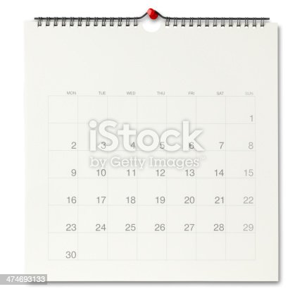 wall calendar page with a red push pin./isolated on white with clipping path