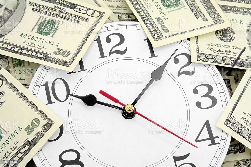 wall clock and dollars stock photo