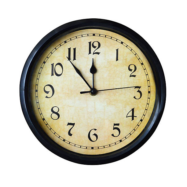 Wall clock - isolated over white stock photo