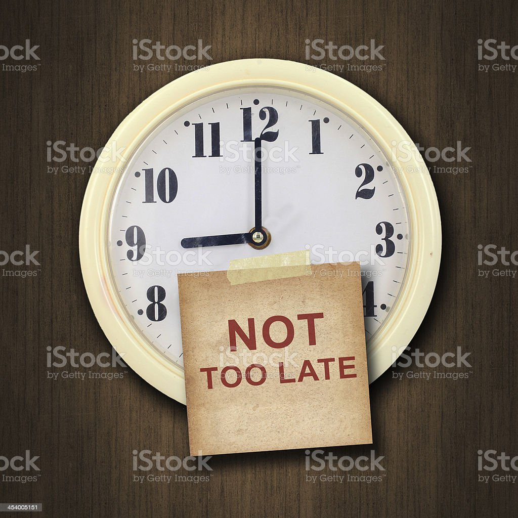 wall clock on the wood background stock photo