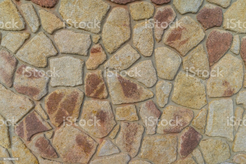 Wall composed of large stone stock photo