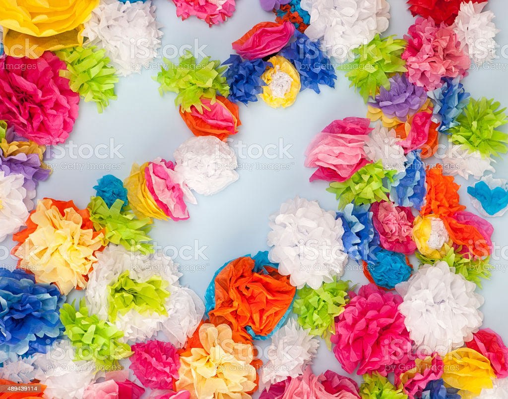 Wall Covered in Paper Flowers stock photo