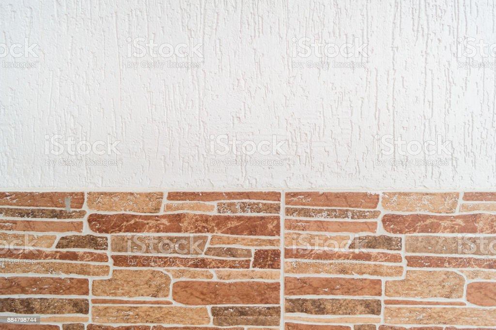 pared cubierta de yeso blanco con piedra artificial decorativa desde abajo fondo textura foto - Piedra Artificial Decorativa