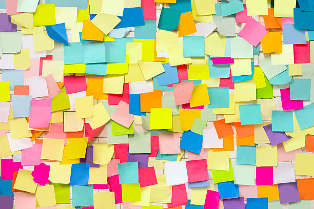 wall covered with adhesive note papers - post it foto e immagini stock