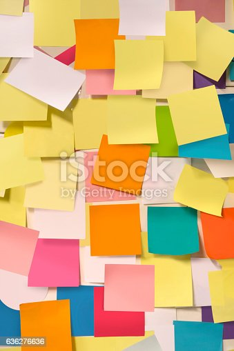istock Wall covered with adhesive note papers 636276636