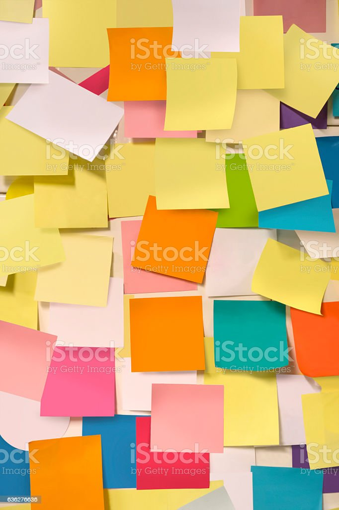 Wall covered with adhesive note papers stock photo
