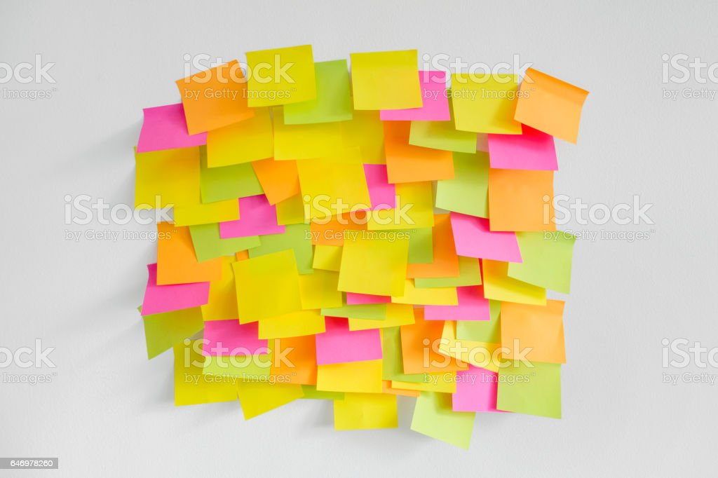 wall covered with adhesive notes stock photo
