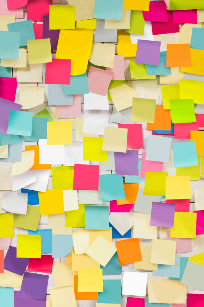 wall covered with adhesive notes - adhesive note stock photos and pictures