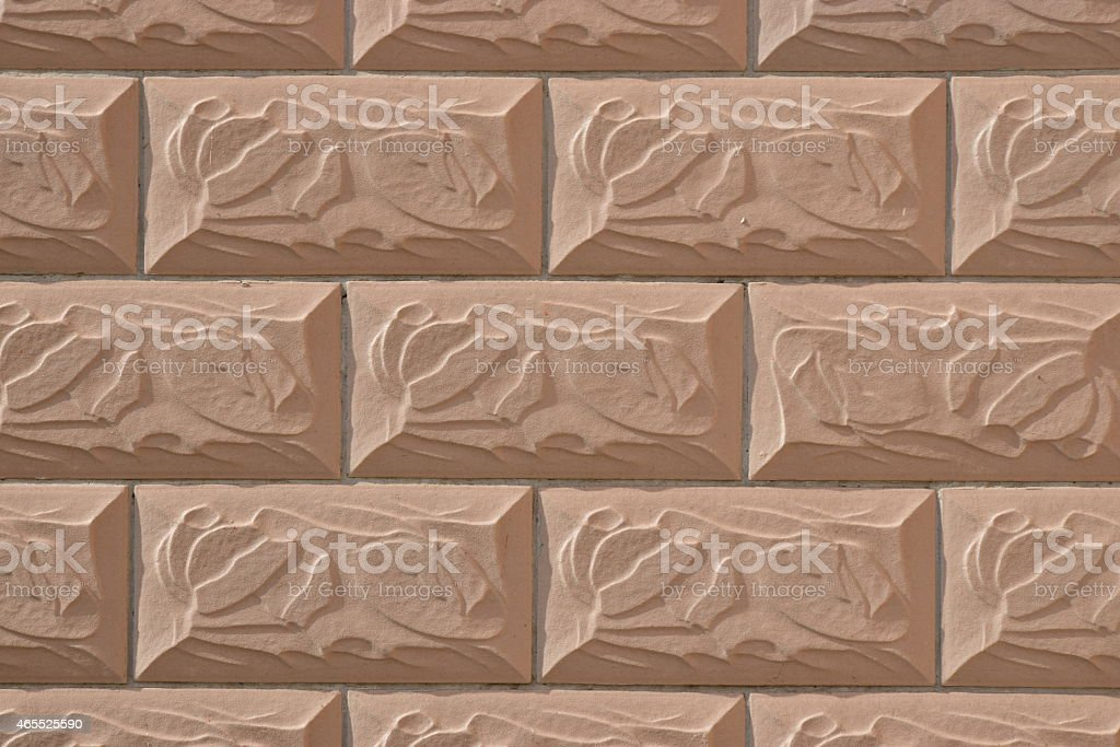Wall covered with figurine tiles stock photo