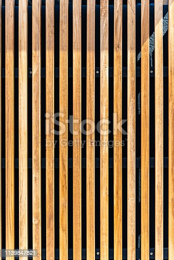 Wall covering with wooden slats. Natural wood texture. Background