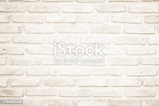 Wall cream brick wall texture background in room at subway. Brickwork stonework interior, rock old clean concrete grid uneven abstract weathered bricks tile design, horizontal architecture wallpaper.