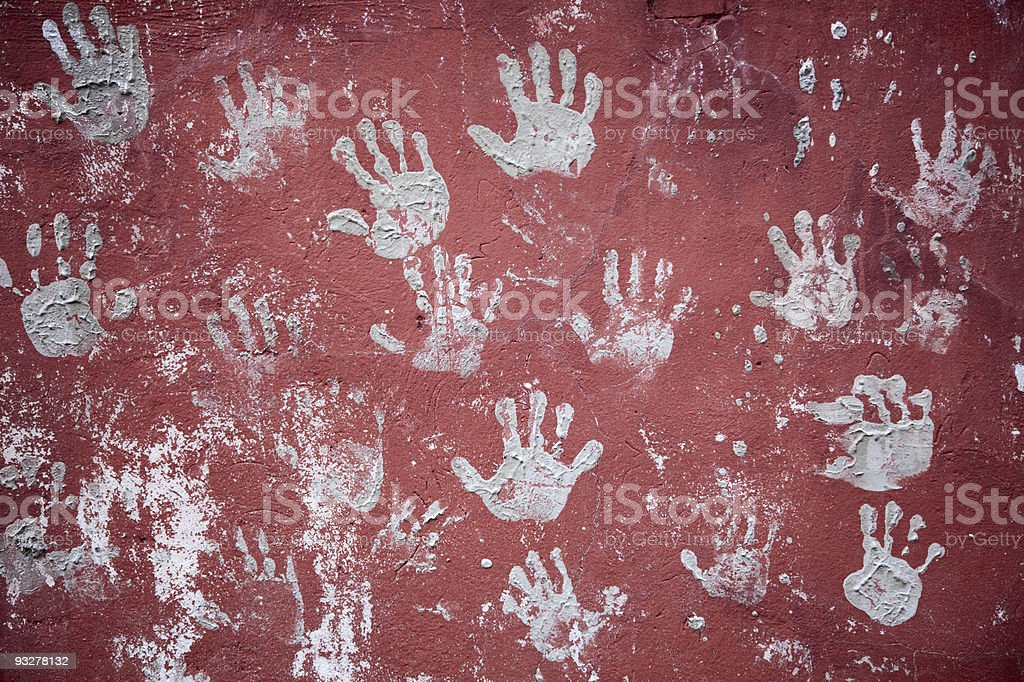 Wall decorated with amusing prints of palms royalty-free stock photo