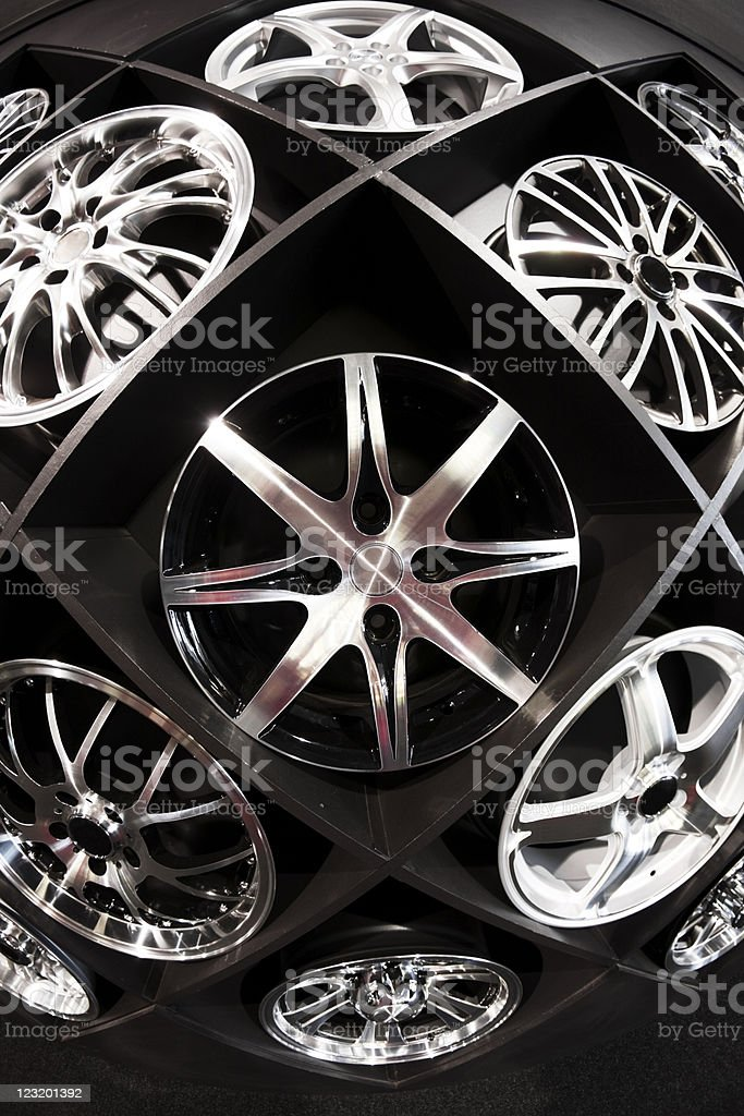 Wall display of automobile wheels shot with fisheye lens stock photo