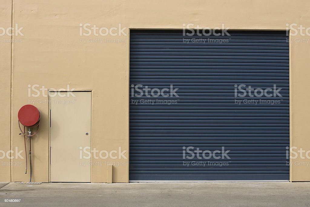 wall, door and fire hose royalty-free stock photo