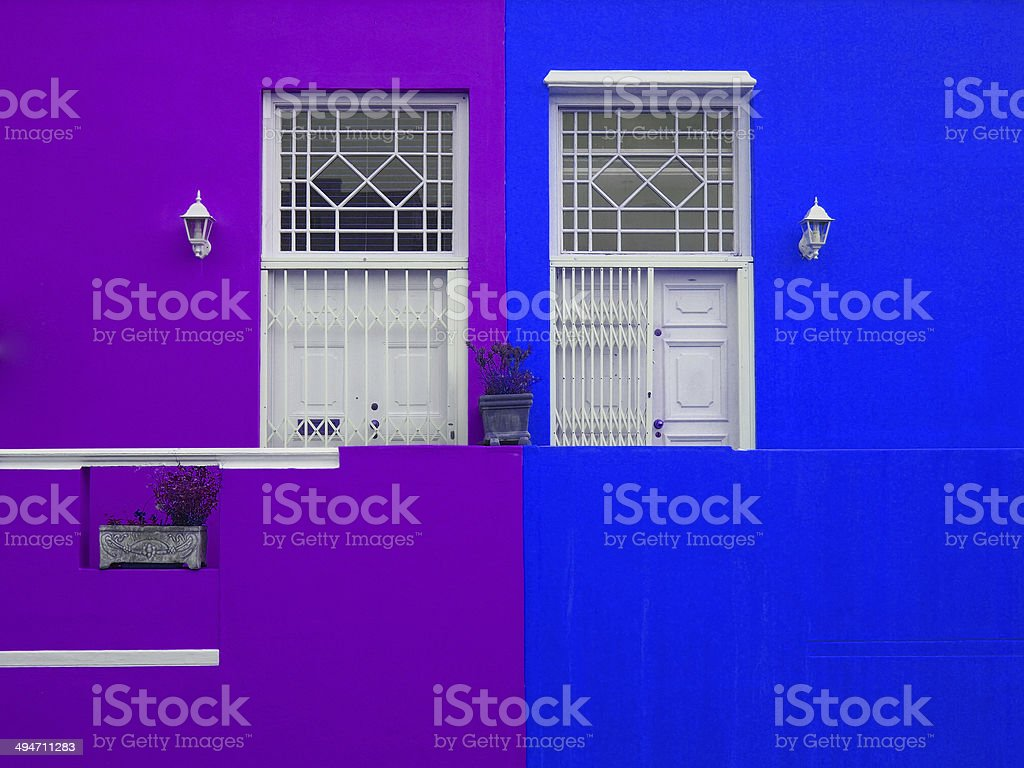 Wall. Doors to balcony. Bright colors. Purple and blue stock photo