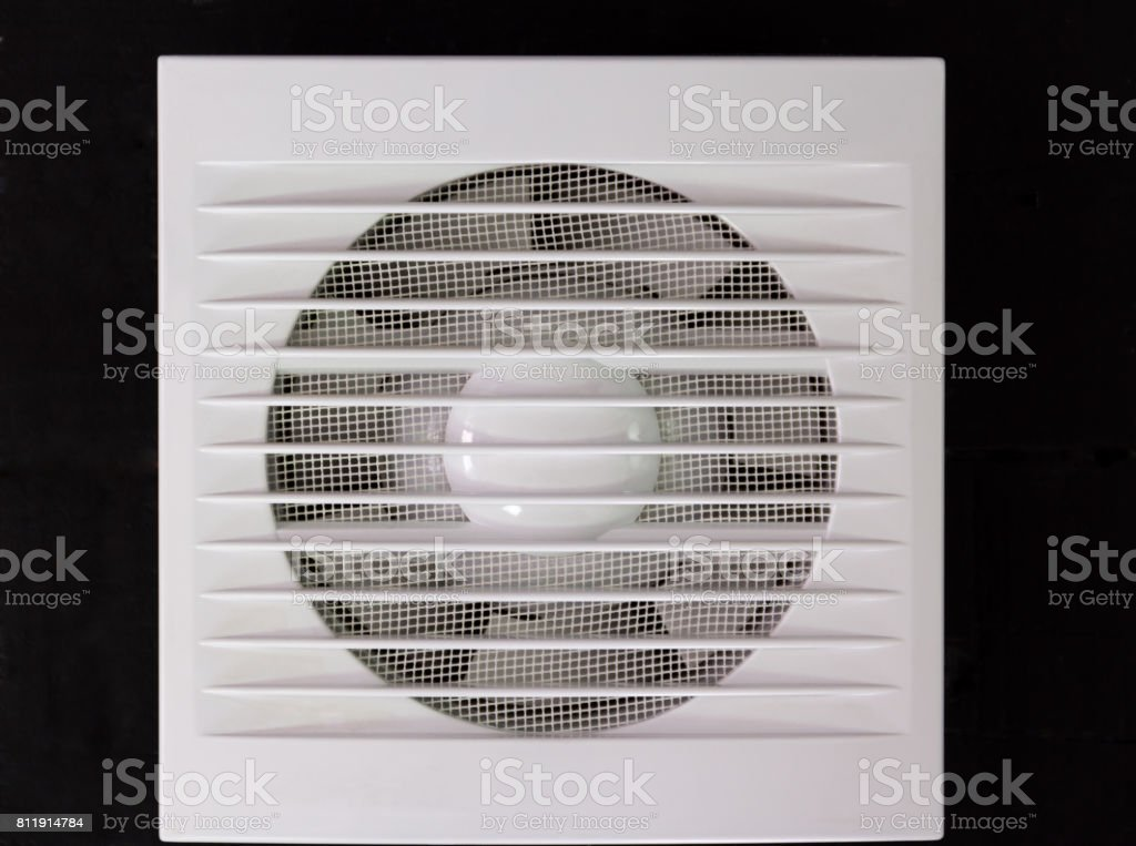 Wall electric extractor fan for bathroom. Closeup stock photo