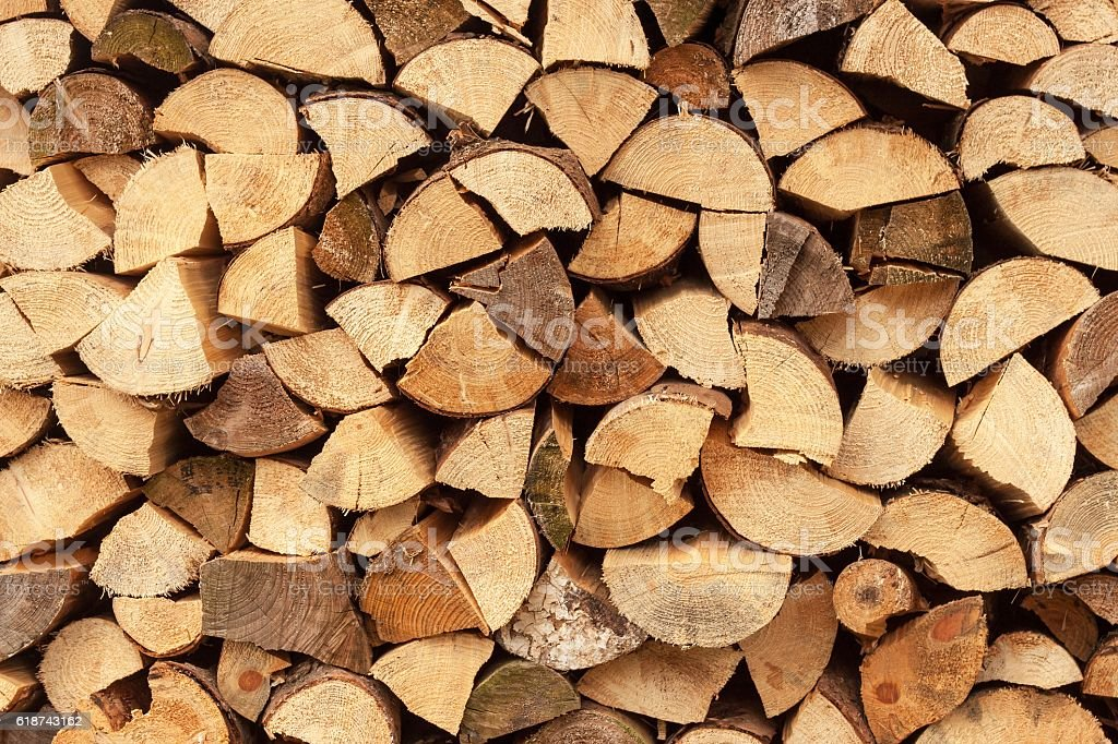 wall firewood , Background of dry chopped firewood stock photo