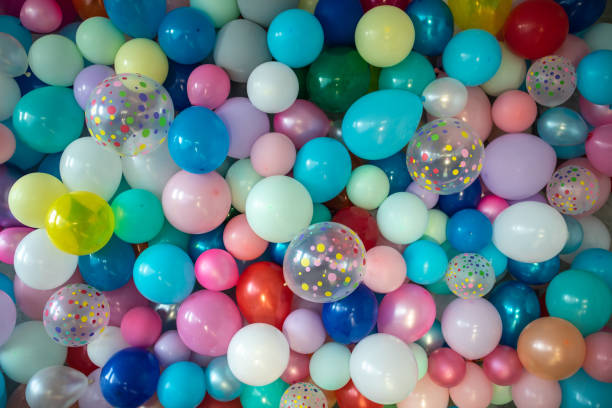 Wall full of colorful balloons Wall full of colorful balloons, bunch of balloons hanging birthday background stock pictures, royalty-free photos & images