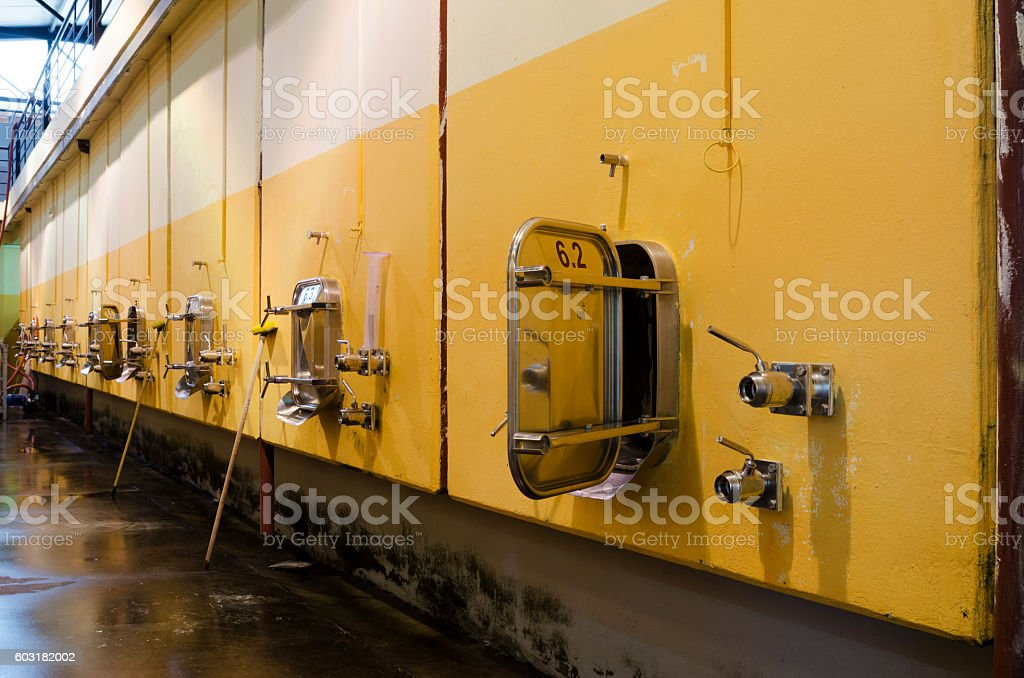 Wall in Bulgarian winery with stainless steel fermentation vessels stock photo