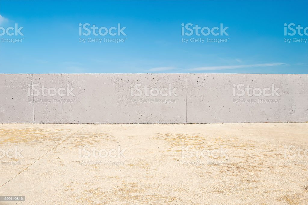 wall in front of blue sky stock photo