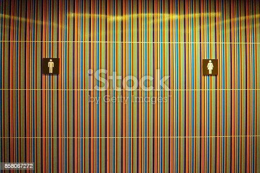 istock wall in front of toilet with sign or symbol of Man and Women 858067272