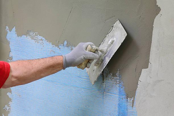 Wall Isolierung, Verbreitung mortar über mesh - – Foto