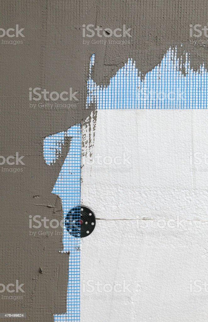 Wall insulation, styrofoam, mesh and mortar stock photo