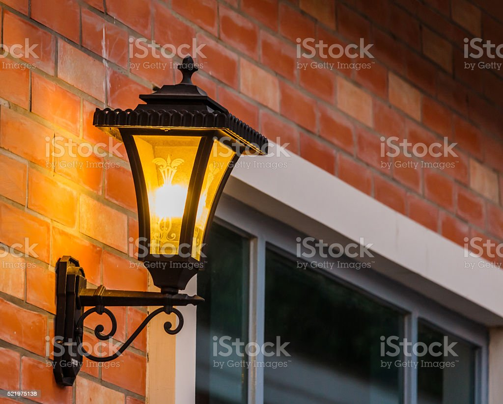 Wall lamp with yellow shade stock photo