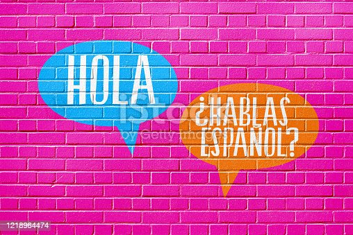 istock A wall, language school and question Speak Spanish 1218964474