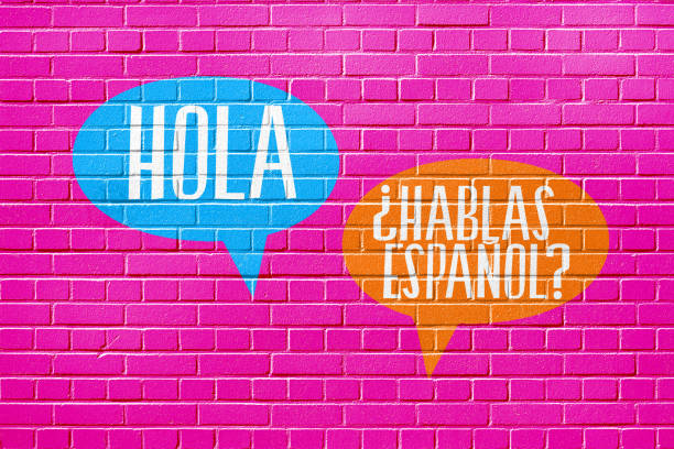 A wall, language school and question Speak Spanish stock photo