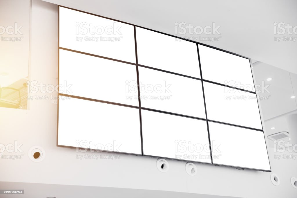 wall LCD display screen panel in modern office building with clipping path at blank screen stock photo