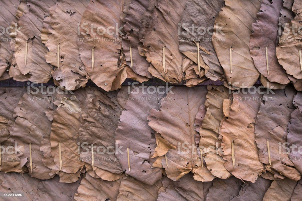 Wall made from dry leaves in the countryside of Thailand stock photo