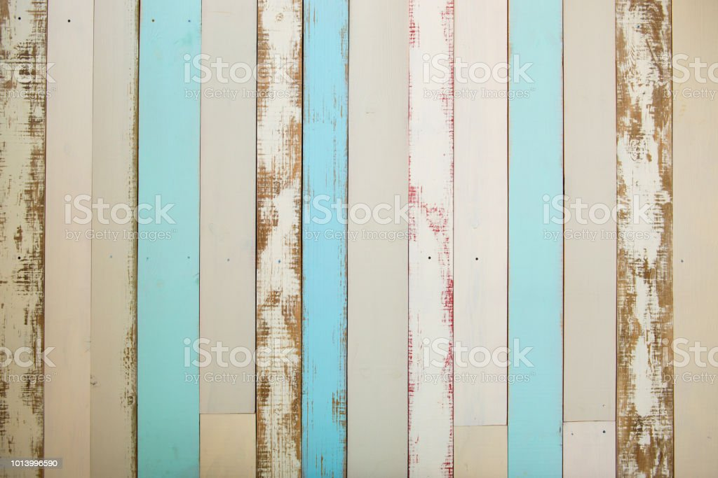 Wall made of multi-colored wooden boards. Abstract grunge wood texture background стоковое фото