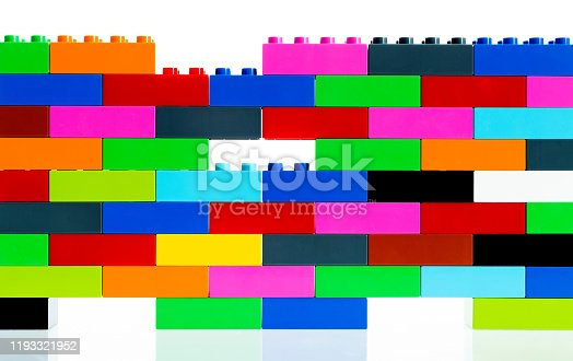 Wall made of plastic blocks on white background.